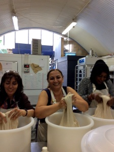 Tahmineh, Nazy and Noha stretch the dough